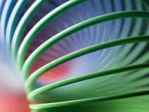 Spring slinky background. Color interlaced slinky spiral background Royalty Free Stock Photo