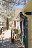 Spring in a small town. A strip shopping area in town with the spring trees in full bloom stock photography