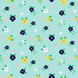 Spring small wild flower field seamless pattern. Floral blue millefleur vector pattern on blue background. For fabric textile prints and apparel Royalty Free Stock Image