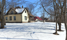 Spring snow and house Stock Photo