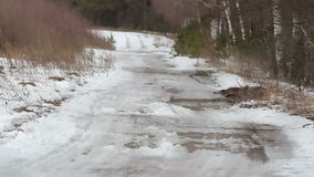 Spring snow melts on the road. Hd stock video footage