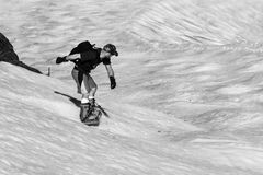 Spring snow surfing. Royalty Free Stock Image