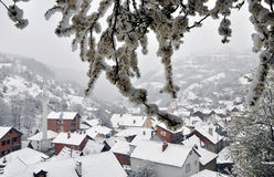 Spring snowfall. Krushevo village, Kosovo covered in snow as the Shar mountain range remains misty during the snowfall Stock Photography