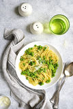Spring spaghetty with broccoli and green pea.Top view. Stock Photos
