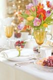 Spring special occasion dining with white pink and blue theme. Spring Easter, Mother`s Day or special occasion dining table with white linens and a bright Royalty Free Stock Image