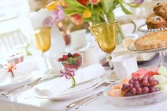 Spring special occasion dining with white pink and blue theme. Spring Easter, Mother`s Day or special occasion dining table with white linens and a bright Royalty Free Stock Photo
