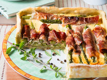 Spring square quiche with asparagus, prosciutto and marjoram Stock Photography