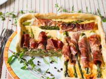 Spring square quiche with asparagus, prosciutto and marjoram Stock Image