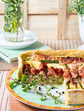 Spring square quiche with asparagus, prosciutto and marjoram Royalty Free Stock Image