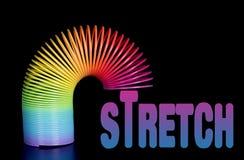 Spring Step - el estiramiento del asunto, alcance, amplía la metáfora Imagen de archivo libre de regalías