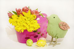 Easter eggs with tulips and daffodils Stock Photography