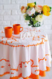 Spring still life with flowers and orange cups Royalty Free Stock Photography