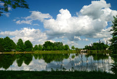 Spring Storm Brewing. View of spring thunderstorm in the making from across a pond Stock Images
