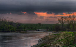 Spring storm over the Des Moines river. A spring storm rolling over the Des Moines river south of the Saylorville spillway Royalty Free Stock Photo