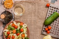 Spring summer diet salad with strawberries, cucumber, green field salad and yogurt mint sauce served in blue plate with cloth napk. In over grey texture stock photography