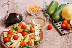 Spring summer diet salad with strawberries, cucumber, green field salad and yogurt mint sauce served in blue plate with cloth napk. In over grey texture stock photos
