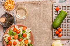 Spring summer diet salad with strawberries, cucumber, green field salad and yogurt mint sauce served in blue plate with cloth. Napkin over grey texture royalty free stock photo