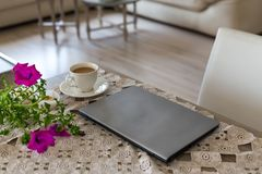 Spring and summer freelance and home office concept. Laptop and stock image