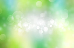 Spring summer green blurred background. Light green natural blur spring summer background.Fresh abstract sunlight design wallpaper Stock Image