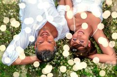 Spring summer starts. Relaxing adult couple toegther in the grass royalty free stock image