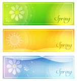 Spring with sun and flowers banners. Text spring with sun and flowers in banners with frame over green yellow and blue backgrounds, seasonal flat design labels Royalty Free Stock Photo