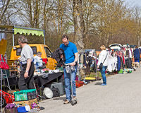 Spring and sunday morning: shoppers stroll leisurely at the open Royalty Free Stock Image