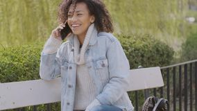 Spring or sunny Autumn outdoor portrait of beautiful mixed race young woman stock footage