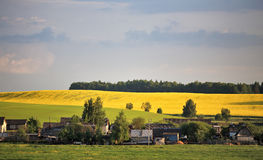 Spring sunny village in the hills Stock Photo