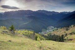 Spring sunrise in the Carpathians. Landscape of Bucegi Mountains at Moeciu - Bran, Romania Royalty Free Stock Photos