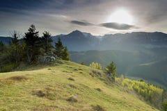 Spring sunrise in the Carpathians. Landscape of Bucegi Mountains at Moeciu - Bran, Romania Stock Photos