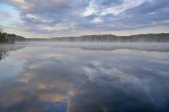 Spring Sunrise Deep Lake. Foggy, spring shoreline of Deep Lake at dawn, Yankee Springs State Park, Michigan, USA Stock Images
