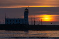 Sunrise at Scarborough Lighthouse in Yorkshire, UK royalty free stock images