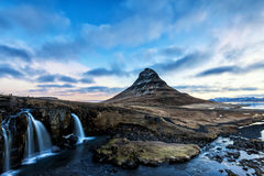 Spring sunrise over the famous Kirkjufellsfoss Waterfall with Ki Royalty Free Stock Image