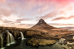 Spring sunrise over the famous Kirkjufellsfoss Waterfall with Ki Royalty Free Stock Photography