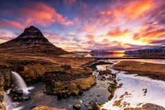 Spring sunrise over the famous Kirkjufellsfoss Waterfall with Ki Stock Images