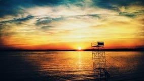 Spring sunset. Beauty sunset on the lake Stock Photos
