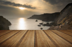 Spring sunset at high tide at Kynance Cove with wooden planks floor Royalty Free Stock Photo