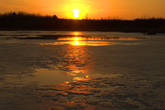 Spring Sunset at McMillan Marsh. This photo was taken in the middle of one of the pools at the marsh. I grabbed my snow shoes for traction and headed out onto stock photography