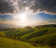 Spring sunset over green hills Royalty Free Stock Photo