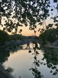 First sunset on Tevere river. A spring sunset on Tevere river with pastel tones royalty free stock photography