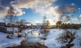 Spring sunset in the village near the river, Russia, Ural, Stock Photography