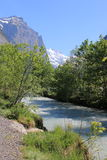 Spring in the Swiss alps, snow on mountains, river Stock Photos