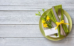 Spring table place setting with daffodils. Holidays background royalty free stock photo