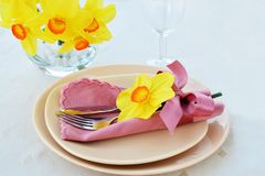 Spring table setting with yellow daffodils stock image