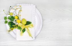 Spring Table Setting for Easter with eggs and leaves. Copy spac Royalty Free Stock Photos
