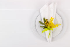 Spring table setting. With mimosa. Holidays background with copyspace Royalty Free Stock Photos