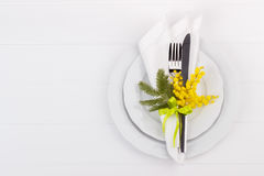 Spring table setting. With mimosa. Holidays background with copyspace Stock Image