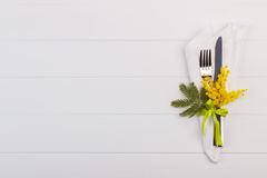 Spring table setting. With mimosa. Holidays background with copyspace Stock Photo