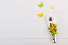 Spring table setting. With mimosa. Holidays background with copyspace Royalty Free Stock Images