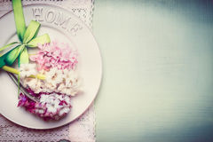 Spring table setting with plate, ribbon and lovely hyacinths flowers , top view, border, pastel Royalty Free Stock Photography